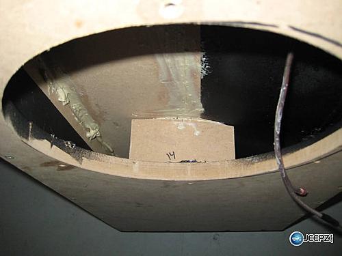 Subwoofer inside of a Jeep Wrangler rear seat-brace_wrangler_subwoofer.jpg