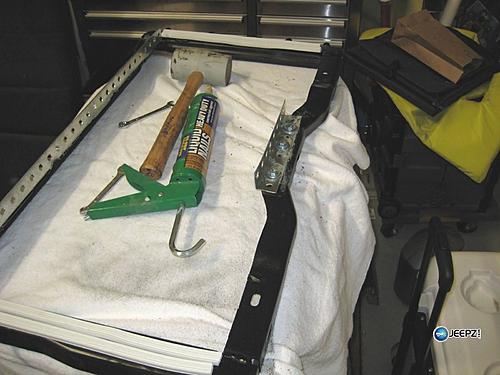 Subwoofer inside of a Jeep Wrangler rear seat-attach1_wrangler_subwoofer.jpg