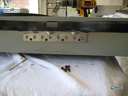 Subwoofer inside of a Jeep Wrangler rear seat-attach3_rwrangler_subwoofer.jpg