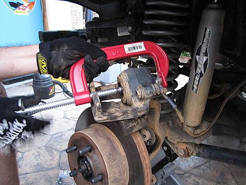 Jeep brake pad change-10_compressing_the_piston.jpg