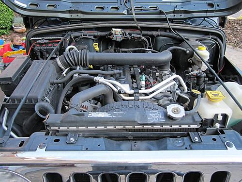 Install a cold air intake on a Jeep Wrangler TJ-02-jeep-wrangler-stock-air-intake.jpg