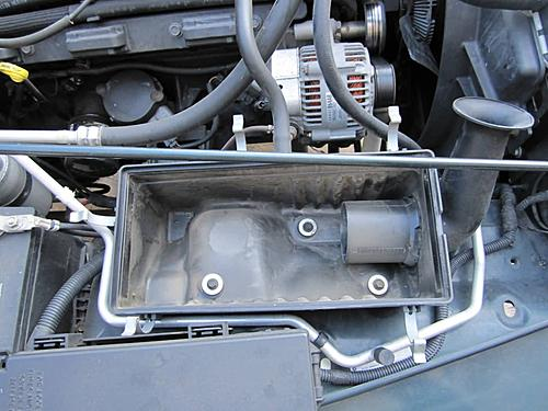 Install a cold air intake on a Jeep Wrangler TJ-08-remove-air-box-bolts.jpg