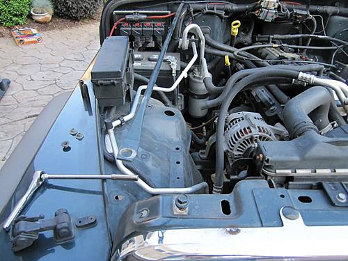 Install a cold air intake on a Jeep Wrangler TJ-10-remove-engine-crossmember.jpg