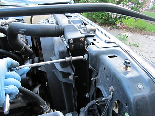 Install a cold air intake on a Jeep Wrangler TJ-11-remove-bolt-radiator-shroud.jpg