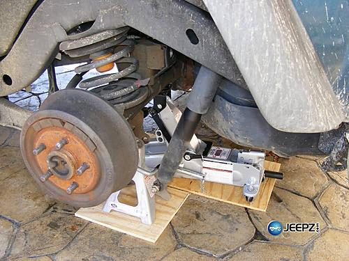 "Lift your TJ - installing a Rubicon Express 2"" coil spacer kit-rear_shock_disconnected_jeep_wrangler_coil_suspension_lift.jpg"