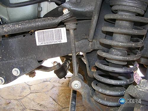 "Lift your TJ - installing a Rubicon Express 2"" coil spacer kit-stock_jeep_wrangler_coil_suspension_lift.jpg"
