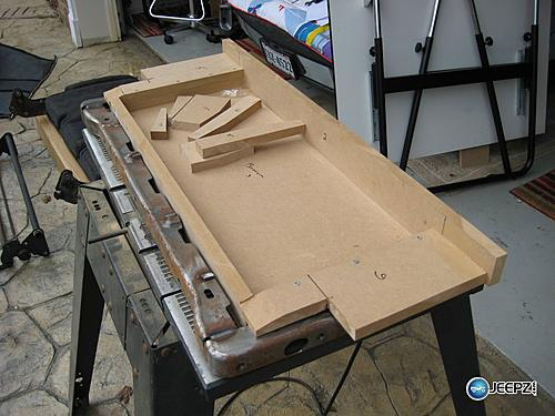 Subwoofer inside of a Jeep Wrangler rear seat-side1_jeep_wrangler_subwoofer.jpg