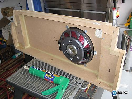 Subwoofer inside of a Jeep Wrangler rear seat-testfit2_jeep_wrangler_subwoofer.jpg