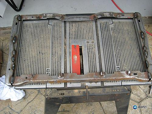 Subwoofer inside of a Jeep Wrangler rear seat-grind_2_wrangler_subwoofer.jpg