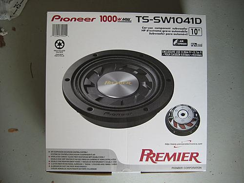 Subwoofer inside of a Jeep Wrangler rear seat-pioneer-jeep-sub.jpg