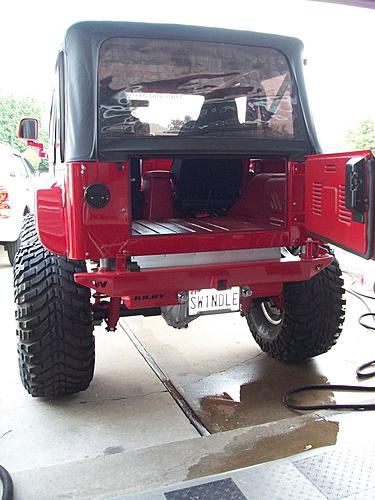 Subwoofer inside of a Jeep Wrangler rear seat-100_1844.jpg