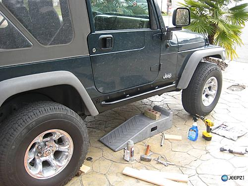 How to install Rock Sliders on a Jeep Wrangler-installed_jeep_wrangler_rock_slider.jpg