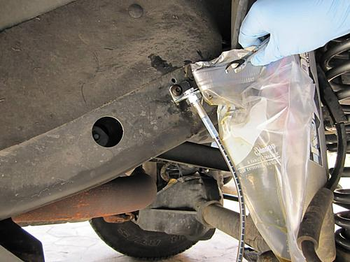 Installing extended Jeep brake hoses-catching-fluid_jeepz.jpg