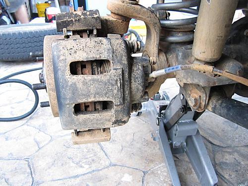 Jeep brake pad change-4_caliper_bolts_removed.jpg