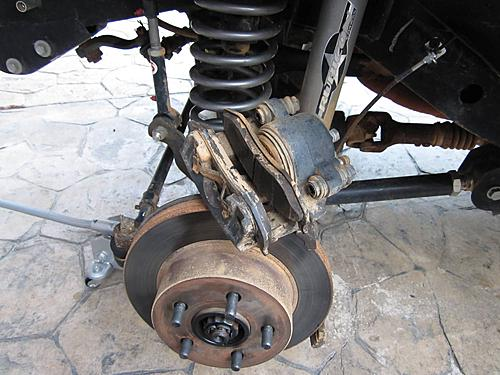 Jeep brake pad change-6_caliper_is_off_the_jeep.jpg