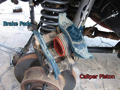 Jeep brake pad change-7_wrangler_caliper_parts.jpg