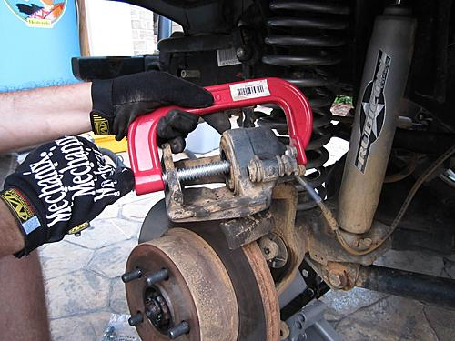 Jeep brake pad change-11_brake_piston_compressed.jpg