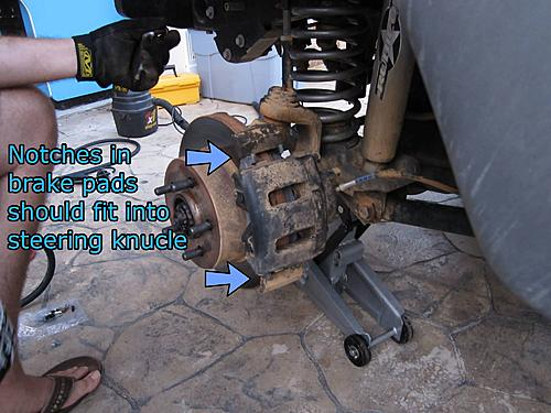 Jeep brake pad change-15_seat_the_caliper.jpg