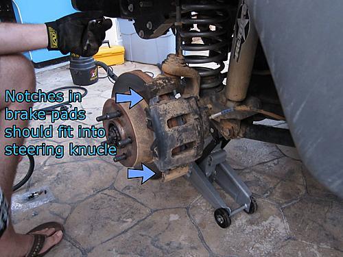 Jeep brake pad change-15_seat_the_caliper.jpg