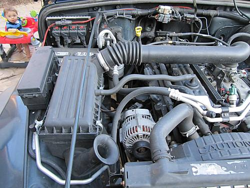 Install a cold air intake on a Jeep Wrangler TJ-03-jeep-wrangler-stock-air-intake.jpg