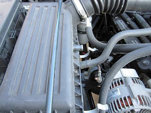 Install a cold air intake on a Jeep Wrangler TJ-05-remove-air-box-hose-.jpg