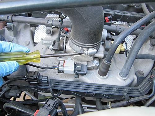 Install a cold air intake on a Jeep Wrangler TJ-07-loosen-hose-clamp-air-intake.jpg
