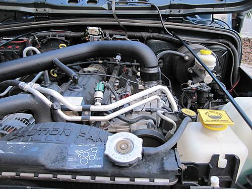 Install a cold air intake on a Jeep Wrangler TJ-wrangler-cold-air-intake-engine-side.jpg