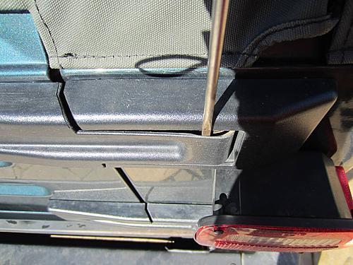 Exogate Tire Carrier-13-remove-hinge-cover.jpg