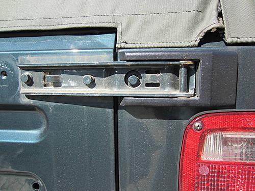 Exogate Tire Carrier-14-remove-hinge-cover.jpg