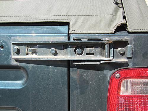 Exogate Tire Carrier-15-remove-hinge-cover.jpg