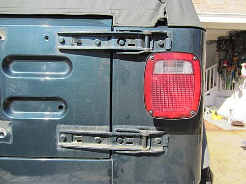 Exogate Tire Carrier-16-remove-hinge-cover.jpg