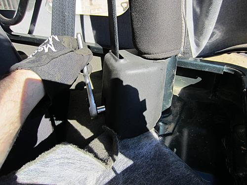 Exogate Tire Carrier-18-remove-seat-belt.jpg
