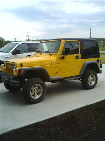 """Lift your TJ - installing a Rubicon Express 2"""" coil spacer kit-lifted-yellow-jeep.jpg"""