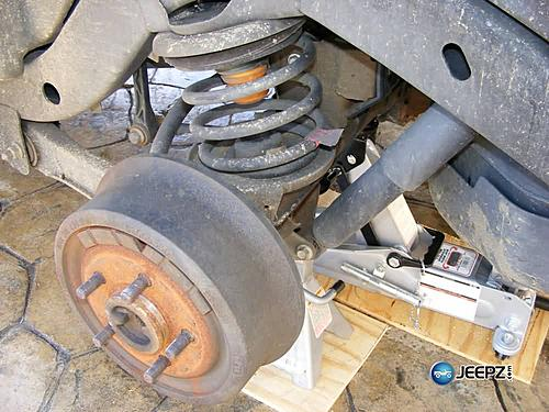 """Lift your TJ - installing a Rubicon Express 2"""" coil spacer kit-remove_wheel_jeep_wrangler_coil_suspension_lift.jpg"""