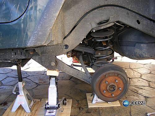 "Lift your TJ - installing a Rubicon Express 2"" coil spacer kit-remove_coil_jeep_wrangler_coil_suspension_lift.jpg"