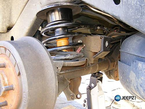 """Lift your TJ - installing a Rubicon Express 2"""" coil spacer kit-jack_up_axle_jeep_wrangler_coil_suspension_lift.jpg"""
