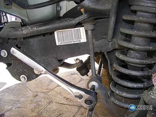 "Lift your TJ - installing a Rubicon Express 2"" coil spacer kit-taking_off_tie_rod_jeep_wrangler_coil_suspension_lift.jpg"