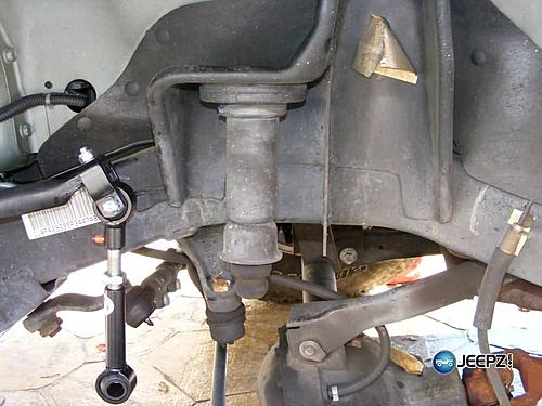 """Lift your TJ - installing a Rubicon Express 2"""" coil spacer kit-remove_coil_jeep_wrangler_coil_suspension_lift.jpg"""